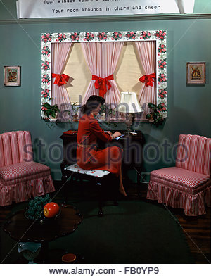 Furniture with model at Marshall Field and, 1943 Dec. 8. Living room, woman sitting at a writing desk., Image forms - Stock Photo