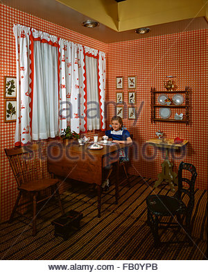 Furniture with model at Marshall Field and, 1943 Dec. 8. Country-style kitchen with plaid wallpaper., Image forms - Stock Photo