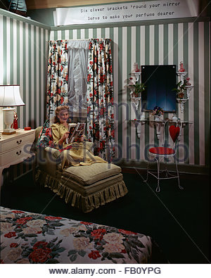 Furniture with model at Marshall Field and, 1943 Dec. 8. Bedroom with woman sitting reading a magazine., Image forms - Stock Photo