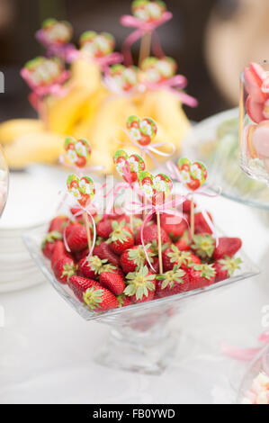 sweet strawberry on the wedding reception at a restaurant - Stock Photo
