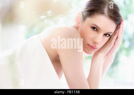 Portrait of beautiful woman in spa - Stock Photo