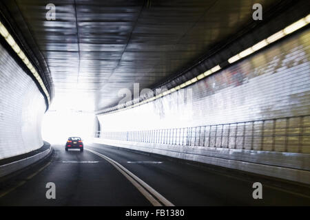 Car driving in tunnel - Stock Photo