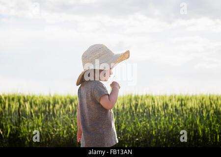 Portrait of girl in straw hat - Stock Photo