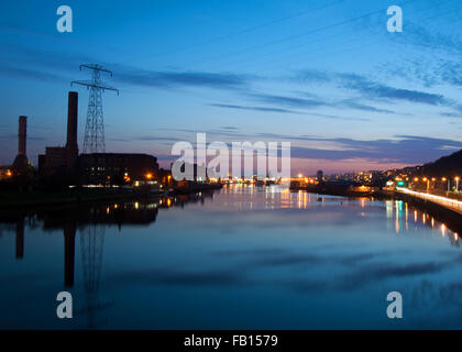 The ESB building and Cork City docks on the River Lee, Cork, Ireland, at night. - Stock Photo