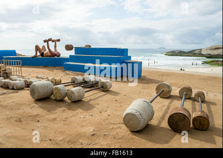 RIO DE JANEIRO, BRAZIL - FEBRUARY 12, 2015: Brazilian man exercises at the outdoor workout station at Arpoador, - Stock Photo