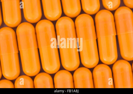 Close-up of orange pills - capsule form made of gelatin (these orange ones are a vegetarian form of capsule). Trump - Stock Photo
