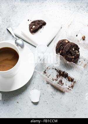 Overhead view of cup of coffee and chocolate chip cookies - Stock Photo