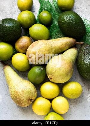Overhead view of yellow and green colour fruits - Stock Photo