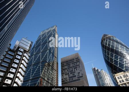 Low angle view of the Gherkin, Lloyds Building and the Cheesegrater, London, UK - Stock Photo