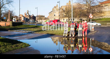 Members of the Fire and Rescue Service conferring, Tower Street, York, Christmas 2015, Yorkshire, England, UK - Stock Photo