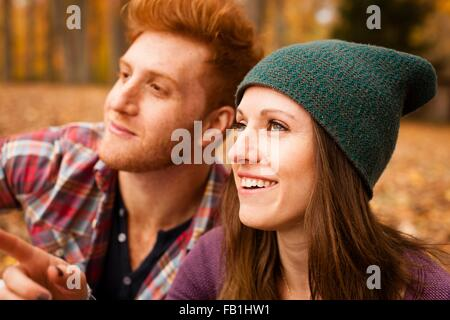 Happy young couple in autumn forest - Stock Photo