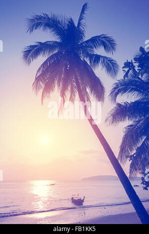 Vintage toned tropical beach at sunset. - Stock Photo