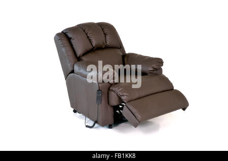 Brown reclining leather chair with controls - Stock Photo