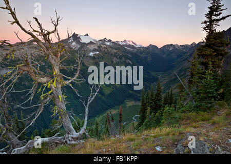 WASHINGTON - Sunrise on Clark Mountain and Glacier Peak from Little Giant Pass overlooking the Napeequa River Valley. - Stock Photo