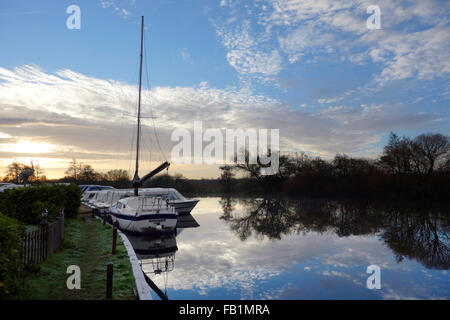 Early morning reflections in the river Bure at Horning Ferry - Stock Photo