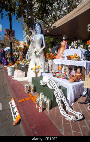 An altar honoring a deceased family member is exhibited on the Mexican Day of the Dead or Dia des Muertos in a Hispanic - Stock Photo
