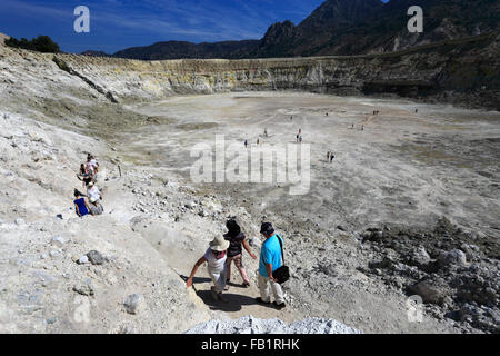 People at the Stefanos crater, volcano of Nisyros island, Dodecanese group of islands, South Aegean Sea, Greece. - Stock Photo