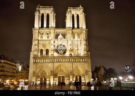 West Portal, Gothic cathedral Notre Dame de Paris at night, Ile da la Cite, Paris, Ile-de-Fance, France - Stock Photo