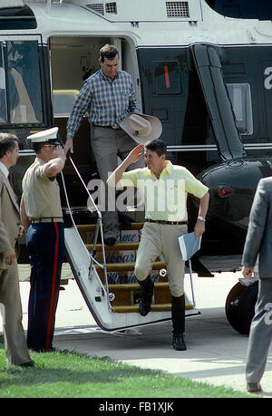Washington, DC., USA,  July 1981 President Ronald Reagan salutes as he walks off Marine One after returning to Washington - Stock Photo