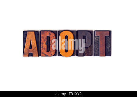 The word 'Adopt' written in isolated vintage wooden letterpress type on a white background. - Stock Photo