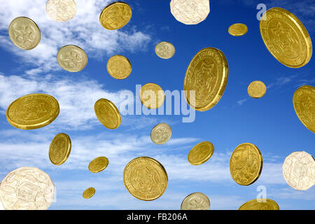 coins  falling from a blue sky with clouds - Stock Photo