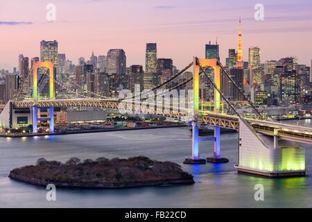Tokyo, Japan skyline with Rainbow Bridge and Tokyo Tower. Stock Photo