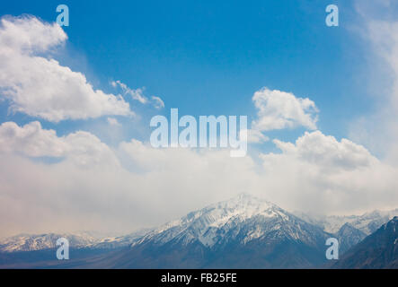 Big clouds over snowy mountains - Stock Photo