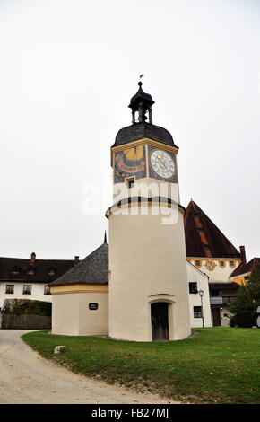 The clock tower within the fifth courtyard of Burghausen Castle - Stock Photo