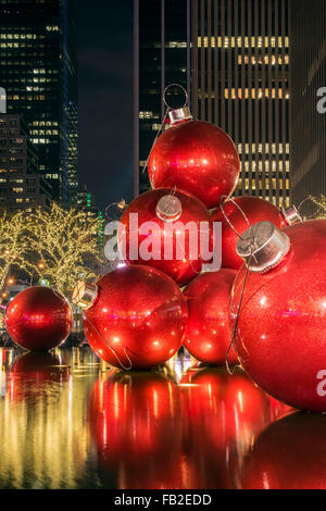 Giant red Christmas ornaments on display on Avenue of Americas (6th Avenue) during the holiday season, Manhattan, - Stock Photo