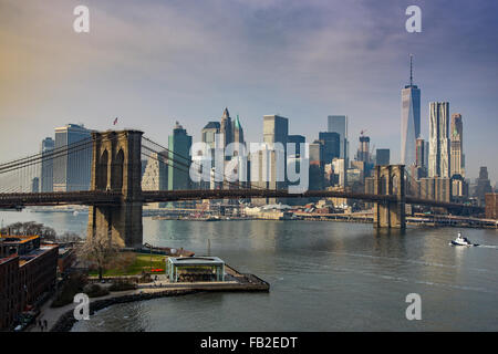 Brooklyn Bridge and Lower Manhattan skyline, New York, USA - Stock Photo