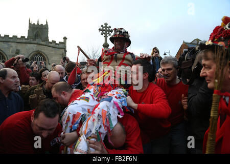 The fool is carried to the mounting block ready to make his speech and then be 'smoked' before the start of the - Stock Photo