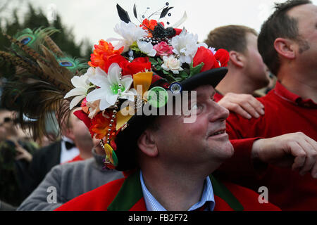 A man in traditional dress watches during the 'smoking of the fool' at the 2016 Haxey Hood. Held annually in the - Stock Photo