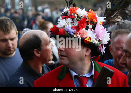 A man wearing tradition costume makes his way through the crowd during the Haxey Hood. Held annually in the small - Stock Photo