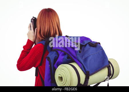 Smiling hipster woman with a travel bag - Stock Photo