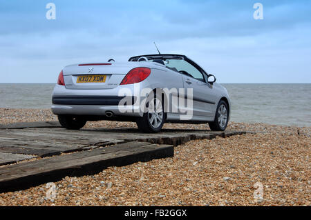Peugeot 206 CC (Coupe Convertible) open top car with folding metal roof - Stock Photo
