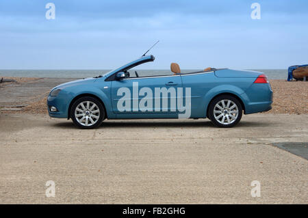 Ford Focus CC (Coupe Convertible) open top car with folding metal roof - Stock Photo