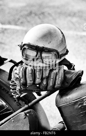 Crash helmet on a vintage Classic british motorcycle. Black and white - Stock Photo