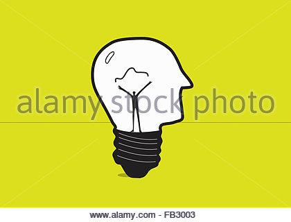 Man forming electric filament inside of human head light bulb - Stock Photo