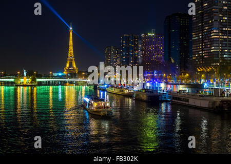 Night view of River Seine with boats and high-rise buildings on the Left Bank, and Eiffel Tower, Paris, France, - Stock Photo