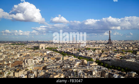 Arc de Triomphe and the Eiffel Tower, elevated city skyline viewed over rooftops, Paris, France, Europe - Stock Photo