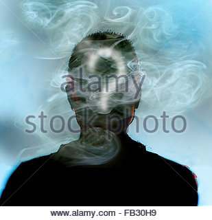 Man smoking with question mark in smoke covering head - Stock Photo