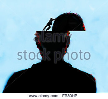 Man opening top of man's head - Stock Photo