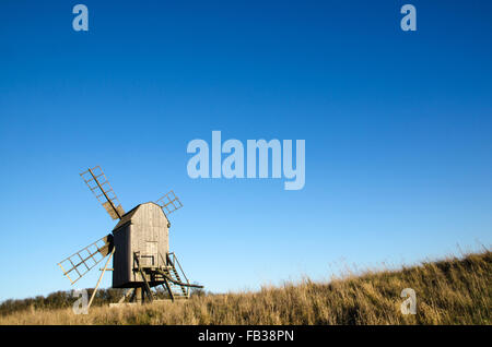 Sunlit old traditional wooden windmill on at the swedish island Oland, the island of sun and wind - Stock Photo