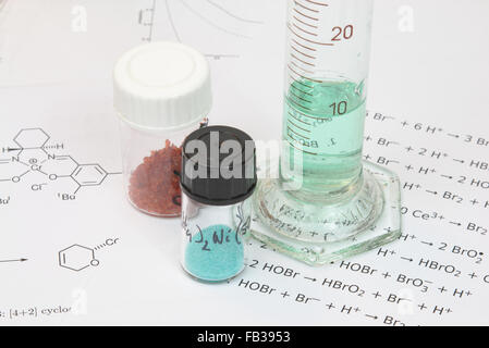 Reagents on a sheet with chemical formulas - Stock Photo