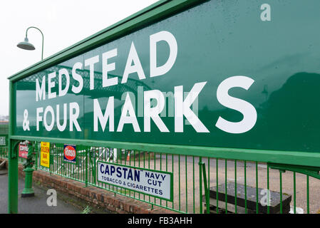 Railway platform sigh showing Medstead and Four marks along the watercress line in Hampshire UK - Stock Photo