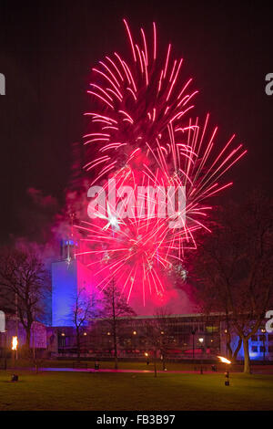A view of Newcastle Civic Centre in Newcastle upon Tyne at night on New Year Eve with a firework display - Stock Photo
