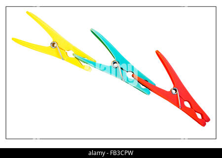 Three coloured pegs clipped together against a white background - Stock Photo