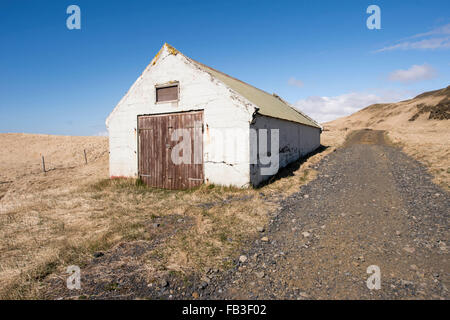 Old barn shelter on a farm in rural Iceland - Stock Photo