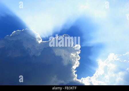 abstract background of sunlight shining through cloud on the blue sky. - Stock Photo