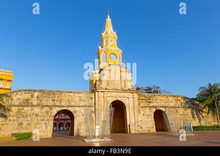 Beautiful clock tower and city gate in the morning in Cartagena, Colombia. - Stock Photo